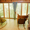 Don Knight/The Herald Bulletin<br /> Sue Blakely cabin offers a great view of the woods on her property near Mechanicsburg. The cabin is self sustaining allowing her to live off the grid.