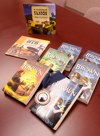 Don Knight/The Herald Bulletin<br /> Warner Press translates their products for distribution to other countries including these books from the Hunter Brown series.