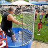 "Anderson Police Chief Larry Crenshaw drops into the water tank as a line of takers form to try their luck at ""dunking the chief"" at the city wide Community Day Saturday held at Anderson Town Center."