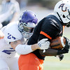 Don Knight/The Herald Bulletin<br /> Defiance College defensive back Tony Sierra tackles Anderson University running back Johnell Wortham on Saturday.