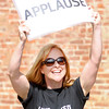 Don Knight/The Herald Bulletin<br /> Dana Donahue holds up an applause sign as United Way kicked off their annual campaign with a video shoot at Town Center Park on Tuesday.