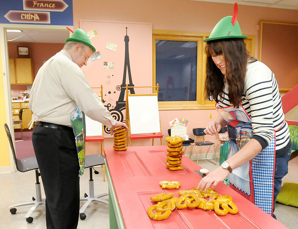 Don Knight/The Herald Bulletin<br /> Erica Gause and Chad Hammond demonstrate pretzel stacking at The Anderson Center for the Arts on Monday. Three new pretzel based activities will be part of The Anderson's annual Octoberfest fund raiser this Thursday.