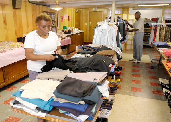 Don Knight/The Herald Bulletin<br /> From left, Rubby Roberts and Johnny Wilson vollunteer at the Allen Chapel AME Clothes Closet on Thursday.