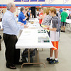 Don Knight/The Herald Bulletin<br /> Dean of Ivy Tech's School of Liberal Arts and Sciences Neil Anthony talks with Jaxon Pardue, 13, during the Madison County Career Expo at Elwood High School and the John Hinds Career Center on Thursday.
