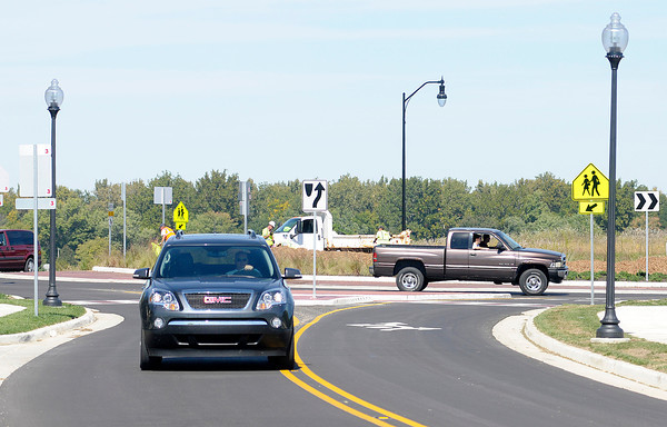 Don Knight/The Herald Bulletin<br /> A motorist drives south on County Road 300 West after exiting a round about in Pendleton on Friday. A ribbon cutting Friday morning celebrated the official opening of the round about on Indiana 38.