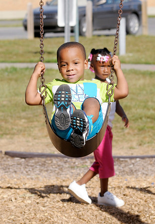 Don Knight/The Herald Bulletin<br /> Anthony Marshown Fuller plays on the swings at Jackson Park on Wednesday. Fuller's birthday was Wednesday, he turned three.