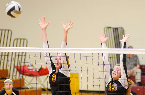 Don Knight/The Herald Bulletin<br /> Alexandria's Allie Hueston (9) and Morgan Oliver (13) attempt a block as the <br /> Tigers hosted Wapahani on Thursday.
