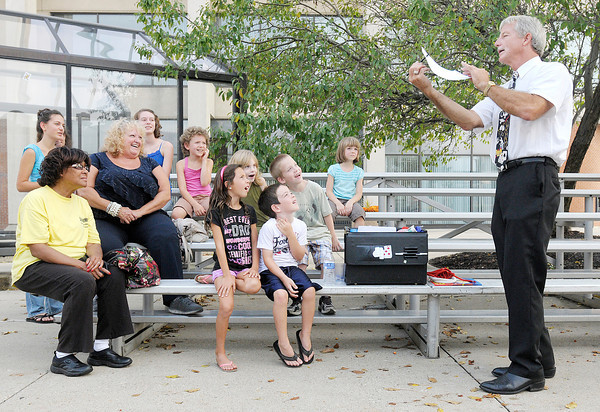 Don Knight/The Herald Bulletin<br /> Magician Jay McLaughlin entertains the crowd at Oktoberfest on Thursday. The event is an annual fundraiser for The Anderson Center for the Arts.