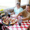 "Don Knight/The Herald Bulletin<br /> Gary and Kristy Webb of Anderson enjoy their pizza at Greeks Pizzeria in Anderson. ""We've never been disappointed here,"" Gary said."