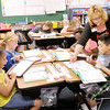 Don Knight/The Herald Bulletin<br /> Third grade teacher Dana Jerrils checks Isaiah Trindad's work as students work on math problems at Liberty Christian on Wednesday. ISTEP test results were released by the state on Wednesday.