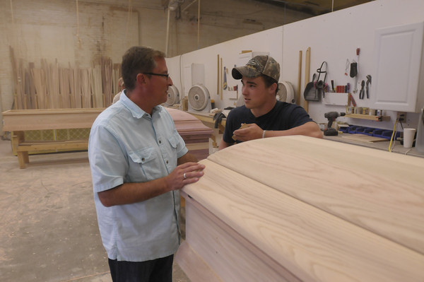 Don Knight/The Herald Bulletin<br /> Chris Boots, founder and president of C.J. Boots Casket Company, talks with Cody Stephenson. The company recently completed an audition tape for a reality T.V. show.