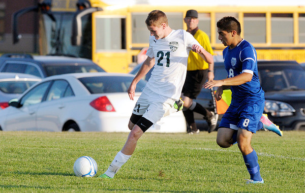 Don Knight/The Herald Bulletin<br /> Pendleton Heights' Dylan Eby takes a shot at the goal as he is pressured by Hamilton Southeastern's Juan Monjaraz on Thursday.