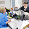 Don Knight/The Herald Bulletin<br /> Dr. Caroline Stevens talks with Kelly Fraser at Central Indiana Neurology.