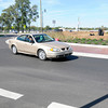 Don Knight/The Herald Bulletin<br /> A motorist drives through the round about on Indiana 38 in Pendleton as a crew works to finish the landscaping on the project on Friday. A ribbon cutting Friday morning celebrated the official opening of the round about.