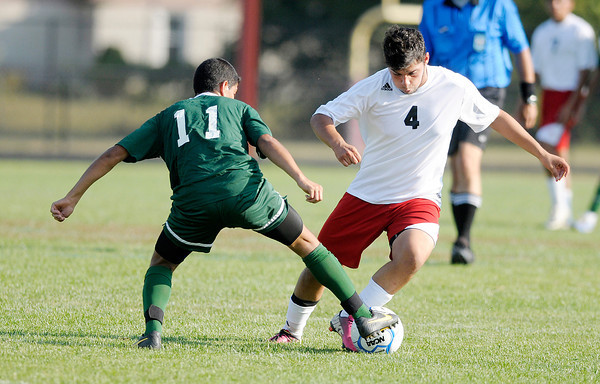 Don Knight/The Herald Bulletin<br /> Pendleton Heights' Nick Ortega stops Anderson's Tristen Rodriquez as the Indians hosted the Arabians on Wednesday.