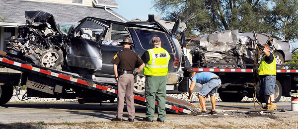 Workers clean up after a two vehicle head-on crash on Ind. 9 near County Road 1300N Friday morning were two people were killed and three others injured.