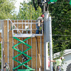Don Knight/The Herald Bulletin<br /> Workers raise the walls for the new MedExpress being built at 38th and Scatterfield on Wednesday.