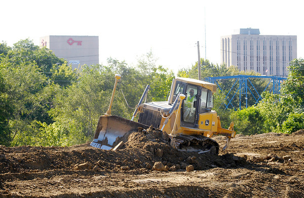 Don Knight/The Herald Bulletin<br /> Anderson's downtown can be seen in the background as the height of the levee at Edgewater Park rises above the river on Tuesday. The new levee will be 21 feet above the level of the river and and should be completed by late 2014.