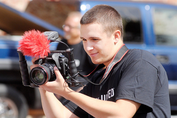 Don Knight/The Herald Bulletin<br /> Josiah Duncan captures video as the United Way kicked off their annual campaign with a video shoot at Town Center Park on Tuesday.