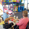 Ken and Sherry Sneed watch their great grandson Logan Hall,2, play as they enjoy lunch at the McDonald's at 2830 Broadway in Anderson Thursday.  The restaurant will close next week to be torn down and a new facility built.