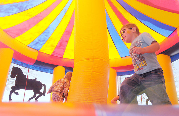 Don Knight/The Herald Bulletin<br /> Keagan Dailey, 4, plays in a bounce house during the Alzheimer's Blowout sponsored by Home Instead Senior Health Care on Saturday. Funds raised through the event benefited the Alzheimer's Association.