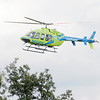Don Knight/The Herald Bulletin<br /> A StatFlight medical helicopter lifts off from a landing zone at East Elementary with a patient from an accident on Indiana 38 east of County Road 100 East on Thursday.