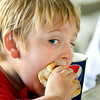 John P. Cleary   The Herald Bulletin<br /> Six year old Jake Madden takes a big bite out of his hot dog while attending the annual Solidarity Labor Council picnic Monday at Beulah Park. Jake is from Alexandria. To view or buy this photo and other Herald Bulletin photos, visit<br /> photos.heraldbulletin.com.