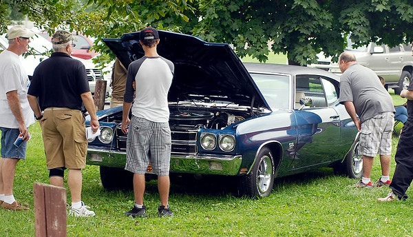 John P. Cleary | The Herald Bulletin<br /> These folks were looking over this Chevrolet Chevelle that was part of the car show at the annual Solidarity Labor Council picnic at Beulah Park in Alexandria Monday. To view or buy this photo and other Herald Bulletin photos, visit<br /> photos.heraldbulletin.com.