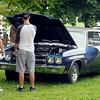 John P. Cleary   The Herald Bulletin<br /> These folks were looking over this Chevrolet Chevelle that was part of the car show at the annual Solidarity Labor Council picnic at Beulah Park in Alexandria Monday. To view or buy this photo and other Herald Bulletin photos, visit<br /> photos.heraldbulletin.com.