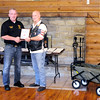 Don Knight | The Herald Bulletin<br /> Post 117 Commander Dewayne Dunn receives a plaque from Jon Cannady  at American Legion Post 117 in Pendleton on Saturday. Cannady organized the Wagons for Warriors project and recognized the groups gold level sponsors on Saturday. The group donated collapsible wagons and household goods to wounded veterans at Walter Reed. Wounded veterans that are well enough to leave the hospital but still need physical therapy stay in apartments but have to cover a large distance from their parking place to the apartment, many of them amputees in wheel chairs. The wagons allow the troops to make fewer trips when carrying items from their cars. After delivering the wagons and seeing the soldiers gratitude and sacrifice the group plans to keep raising funds and buying wagons.