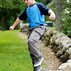 John P. Cleary | The Herald Bulletin<br /> Sam Miller, 8, having fun walking the stone wall in Shadyside Park Monday afternoon while at the park with family for a Labor Day outing.
