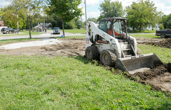 Don Knight | The Herald Bulletin<br /> Mike Fleener with Partners-N-Concrete excavates an area at the southwest corner of Madison Avenue at its intersection with Dr. Martin Luther King Jr. Boulevard on Wednesday. The area will be a new park honoring community leaders.