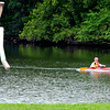 John P. Cleary | The Herald Bulletin<br /> Larry Towne paddles around Shadyside Lake under the watchful eye of the Girl Scout walking man that looks over the north lake Tuesday afternoon.