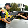 John P. Cleary | The Herald Bulletin<br /> Anderson Firefighter Capt. Matt Cole, and co-workers, were out Labor Day manning the boots to collect for the Muscular Dystrophy Association in their annual Fill the Boot drive over the Labor Day weekend.