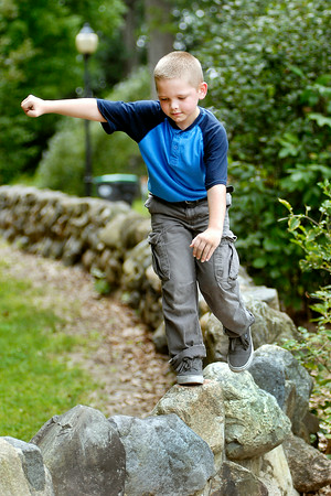John P. Cleary | The Herald Bulletin<br /> Sam Miller, 8, was having fun walking the stone wall around the shelter house in Shadyside Park Monday afternoon while at the park with his family for a Labor Day outing.