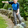 John P. Cleary   The Herald Bulletin<br /> Sam Miller, 8, was having fun walking the stone wall around the shelter house in Shadyside Park Monday afternoon while at the park with his family for a Labor Day outing.