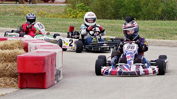 Mark Maynard | for The Herald Bulletin<br /> Karts race through the corner at the Daleville Grand Prix.