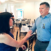 Devan Filchak | The Herald Bulletin<br /> Officer Brian Gehrke, right, talks with Holly Renz of the Anderson Noon Exchange Club, who presented him with the Law Enforcement Officer of the Year award.