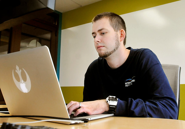 John P. Cleary | The Herald Bulletin<br /> Interactive Intelligence employee Bryan Schultz oversees the company's AU computer lab and the students that work for them.