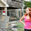 Don Knight | The Herald Bulletin<br /> Megan Sellers looks up at her apartment that was destroyed by fire at Applecreek Apartments. Residents were allowed into their apartments to try to salvage some of their belongings on Friday.