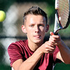 John P. Cleary | The Herald Bulletin <br /> Alexandria's #2 singles player Blake Morehead watches the ball as he swings to return it during his match with Frankton's Cameron Klabunde.