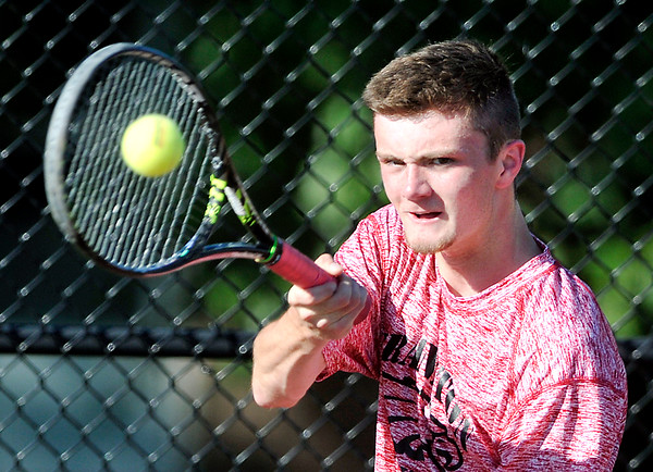 John P. Cleary | The Herald Bulletin <br /> Frankton's Keegan Freestone returns the ball during his #1 singles match with Alexandria's Matthew Hensley. Freestone lost in three sets.