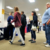 John P. Cleary | The Herald Bulletin<br /> Michelle Ferguson, H.R. generalist for NTN Driveshaft, talks to an applicant as a long line waits to get information on job openings at the Hire Anderson Job Fair Wednesday held at the former Sears store in the Mounds Mall.