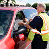 """Don Knight   The Herald Bulletin<br /> Bob Bennett collects donations from motorists as AFD started their """"Fill the Boot"""" fundraiser for MDA on Thursday. The department has set a goal of $22,000."""