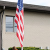 Don Knight | The Herald Bulletin<br /> Trey Hieatt and Hayden Martin lower the flag to half staff during a September 11 Remembrance Service at St. Mary School in Alexandria on Friday.