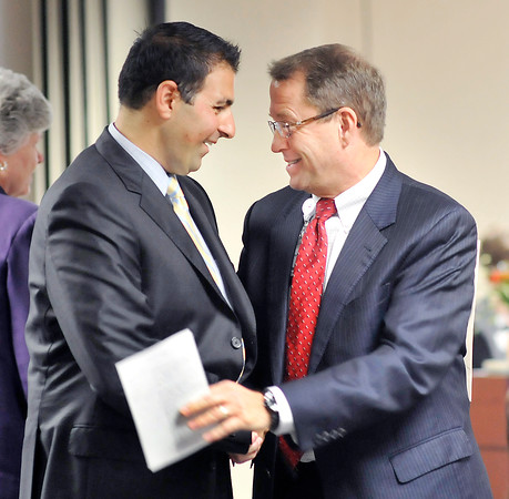 John P. Cleary   The Herald Bulletin <br /> Mike Schroyer, right, Regional President St. Vincent Northeast Region, is congratulated by Jonathan Nalli, Chief Executive Officer of St. Vincent, after Schroyer was commissioned during a ceremony Monday.