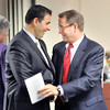 John P. Cleary | The Herald Bulletin <br /> Mike Schroyer, right, Regional President St. Vincent Northeast Region, is congratulated by Jonathan Nalli, Chief Executive Officer of St. Vincent, after Schroyer was commissioned during a ceremony Monday.