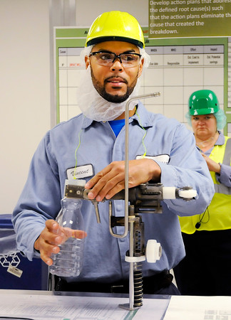 Don Knight | The Herald Bulletin<br /> Vincent Repscher talks about some of the routine maintenance he is learning to do as part of Nestlé's Project Opportunity apprenticeship program. Nestlé and Ivy Tech partnered to create the program that trains employees to fill future vacancies.