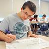 John P. Cleary | The Herald Bulletin <br /> Joe Kirkpatrick works out a math problem during Richard Ziuchkovski's calculus class at Anderson High School Wednesday.  Kirkpatrick is a National Merit Scholarship semi-finalist.