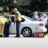 John P. Cleary | The Herald Bulletin<br /> Anderson Fire Department personnel assist one of the persons involved in a multi-vehicle accident at 9th Street and Scatterfield Road Saturday afternoon.